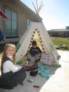 Students enjoying the Laurel Oak teepee.